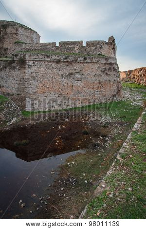 Ruins Of  Fortress Of Methoni And Reflection In  Trench, Peloponnese, Greece