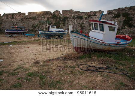 Fishing Boats Near Ruined Walls Of  Fortress Of Methoni