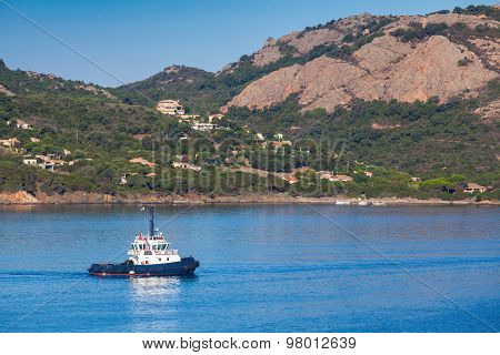 Small Tug Boat  Underway On Porto-vecchio Bay
