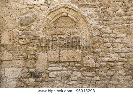 Background Texture, Wall Of Pale Natural Stone With A Bricked Up Arch Window