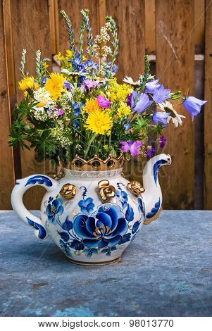 Bouquet Of Wild Flowers In A Teapot