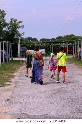 family of Gypsies around the parking lot looking for drive to plunder