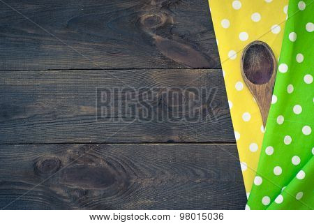 Wooden Table With Spoon And  A Tablecloth