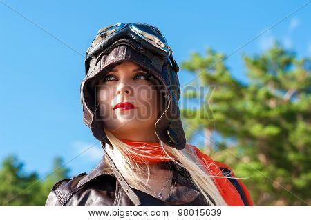 woman in aviator helmet on the sky background