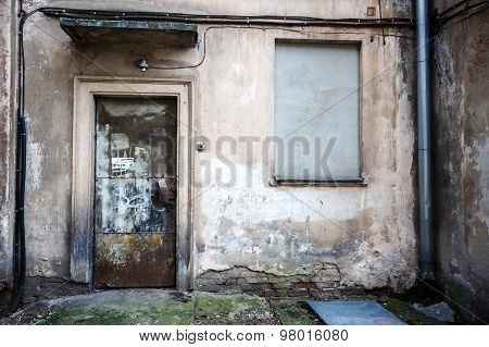 Boarded Up Window And Rusty Door