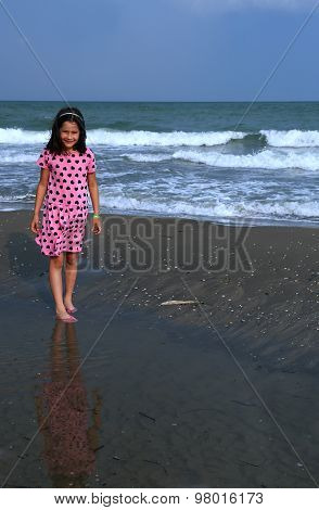 Beautiful Little Girl With Pink Dress With Small Black Hearts