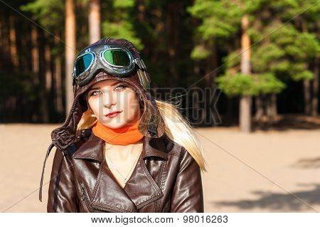 portrait of a woman in helmet of the pilot on a sunny day