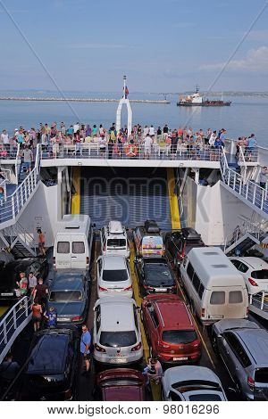 Russia, Caucasus Port, on July 14, 2015: cars on the ferry, transporting them through the Strait of Kerch from the Russian port Caucasus to the Crimea.