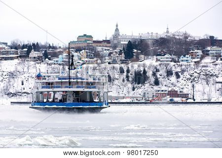 Passenger Ferry crosses the frozen St Lawrence river, Quebec City, Canada. Identifying marks removed.