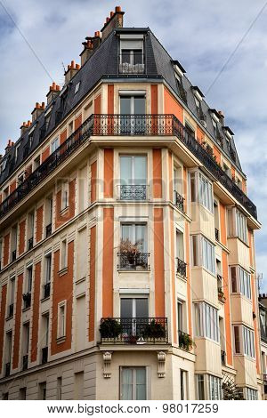 Typical Parisian architecture in the Montmartre area of Paris, France. Decorative appartment building on spring day.