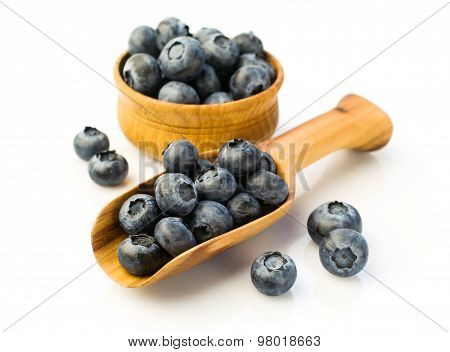 Ripe Blueberries In A Wooden Scoop