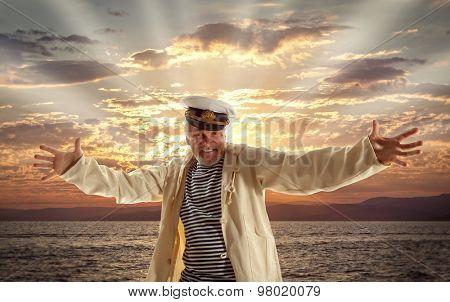 Captain. Happy sailor man on ocean background