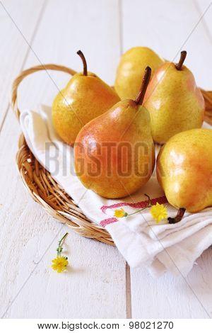 Yellow Pear In Wicker Basket