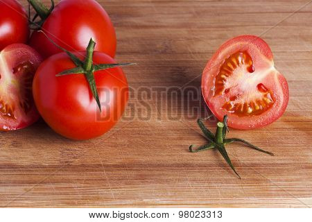 Tomatoes On Chopping Board
