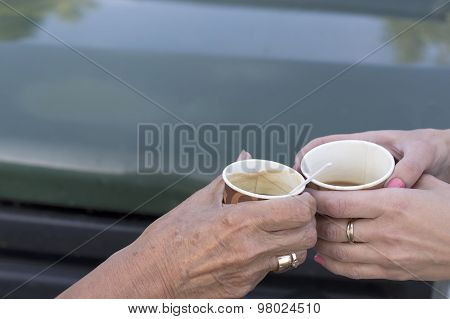 Two Hands With Coffee Cups