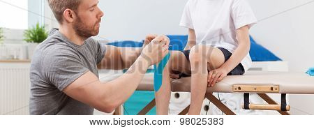 Physiotherapist Working With Little Patient