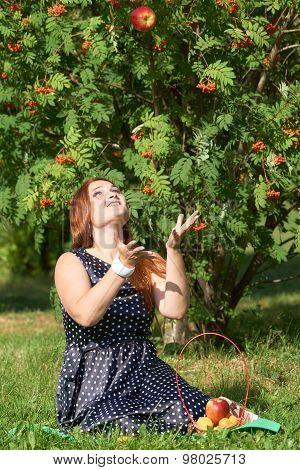 Happy Girl Throws Apple