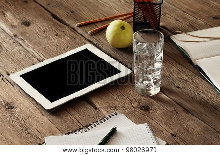 White Tablet Computer With A Blank Screen On The Wooden Table