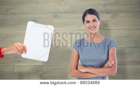 Smiling businesswoman against bleached wooden planks background