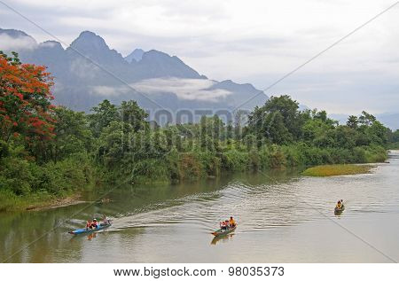 tourists are floating in canoes nearly Vang Vieng, Lao