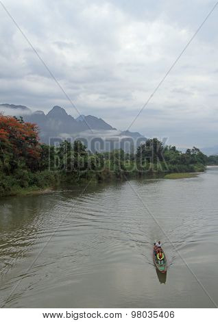 tourists are floating in canoe nearly Vang Vieng, Lao