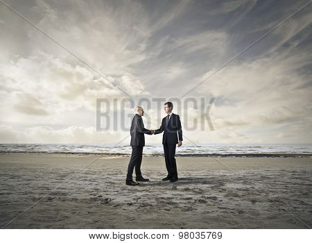 Businessmen meeting at the beach
