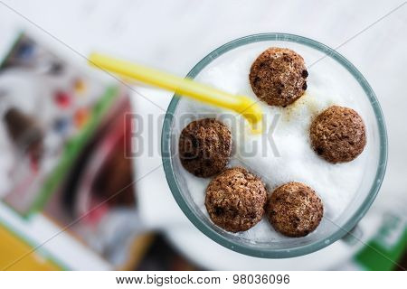 children cappuccino with snacks and straw