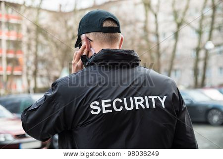Security Guard Listening With Earpiece