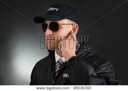 Secret Agent Listening To Earpiece
