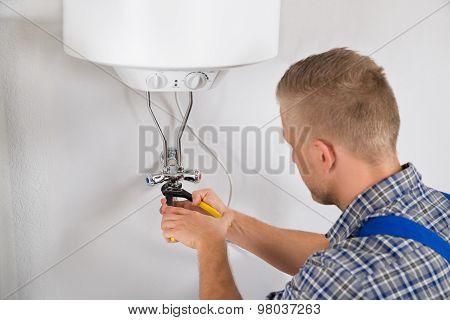 Repairman Repairing Electric Boiler