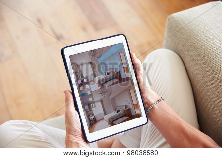 Woman Looking At Decorating App On Digital Tablet