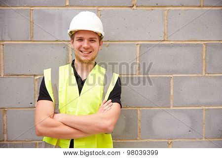 Portrait Of Male Construction Worker On Building Site