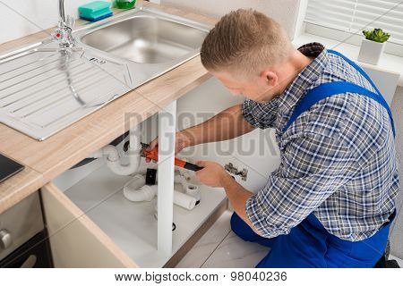 Plumber Fixing Sink Pipe