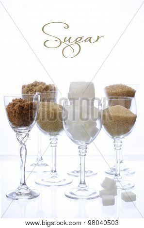 Different Types Of Sugar In Glasses On White.