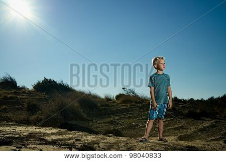 Boy In The Arid Desert Sun