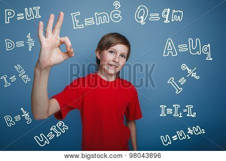 Teenage boy showing OK sign genius physics formulas infographics