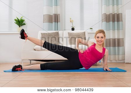 Woman In Sportswear Exercising At Home