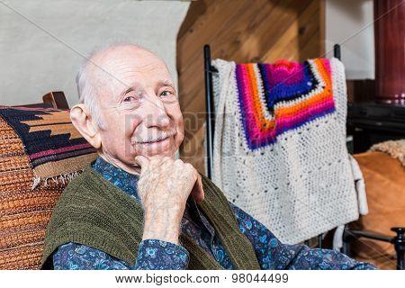 Older Smiling Gentleman Sitting