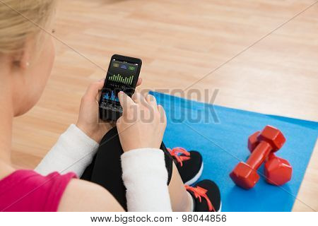 Woman With Mobile Phone Showing Pulse Rate