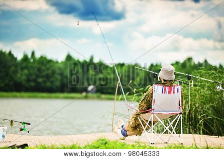 Fishing with spinning from shore of the lake