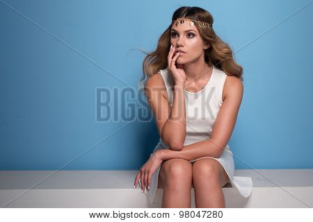 pretty woman wearing headpiece and white dress retro