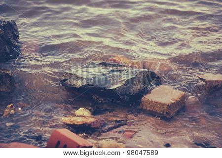 Bricks and stones in water