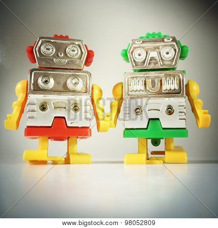 Vintage style of Robot couple holding hands with an Instagram style filter