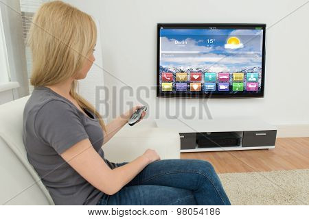Woman In Front Of Television With Apps