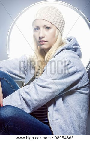 Proud And Sexy Fashion Caucasian Woman In Sweatshirt And Hoody Against Studio Equipment.