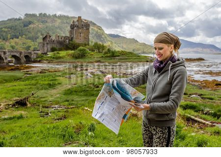 Young woman visiting Scottish Castle
