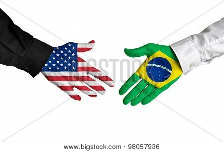 American and Brazilian leaders shaking hands on a deal agreement