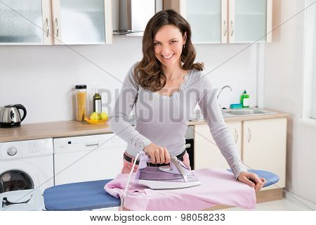 Woman Ironing Cloth With Electric Iron
