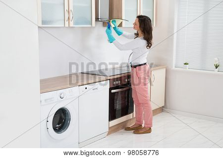 Woman Cleaning Cooker Hood