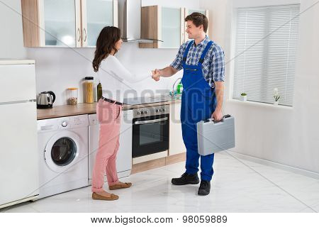 Repairman Shaking Hands With Woman
